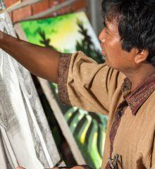 pintor finaliza sua obra